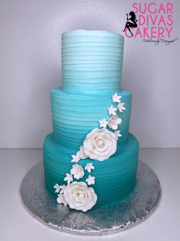 line design turquoisesimplewhite flowerscascadingombrebuttercream